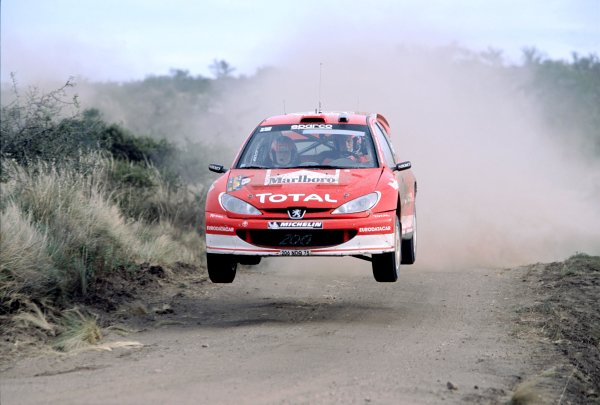 2003 World Rally ChampionshipRally Argentina, Cordoba, Argentina, 7th - 11th May 2003.Rally winner Marcus Gronholm/Timo Rautiainen (Peugeot 206 WRC), action.World Copyright: LAT Photographicref: 03WRCArg06