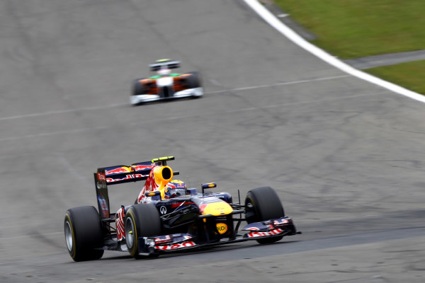 Nurburgring, Germany.24th July 2011Mark Webber, Red Bull Racing RB7 Renault, 3rd position, leads Paul Di Resta, Force India VJM04 Mercedes, 13th position. Action. World Copyright: Andy Hone/LAT Photographicref: Digital Image CSP13226