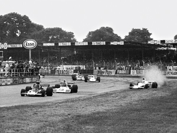 1973 British Grand Prix. Silverstone, England. 12-14 July 1973. Jody Scheckter (McLaren M23 Ford) starts to spin, causing a multiple car accident which caused the race to be stopped. World Copyright - LAT Photographic