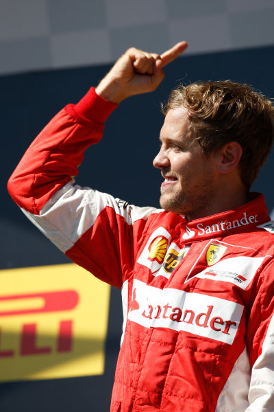 Hungaroring, Budapest, Hungary. Sunday 26 July 2015. Sebastian Vettel, Ferrari, 1st Position, celebrates victory on the podium. World Copyright: Charles Coates/LAT Photographic ref: Digital Image _J5R8432