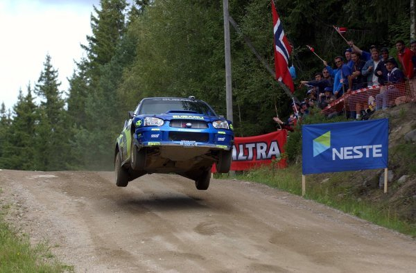 Tommi Makinen (FIN) gets airborne in his Subaru Impreza WRC 2003.FIA World Rally Championship, Rd9, Neste Rally Finland, Jyvaskyla, Finland, Day 3, 10 August 2003.DIGITAL IMAGE
