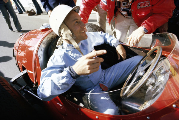 Stirling Moss in a Maserati 250F.