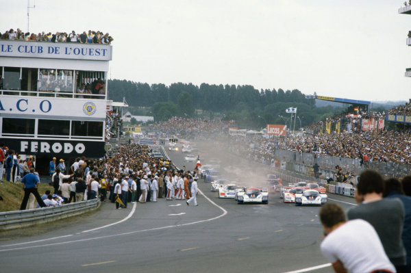 1982 Le Mans 24 hours. Le Mans, France. 19-20 June 1982. Jacky Ickx/Derek Bell (Porsche 956), 1st position, leads at the start of the race, action.  World Copyright: LAT Photographic. Ref:  82LM01.