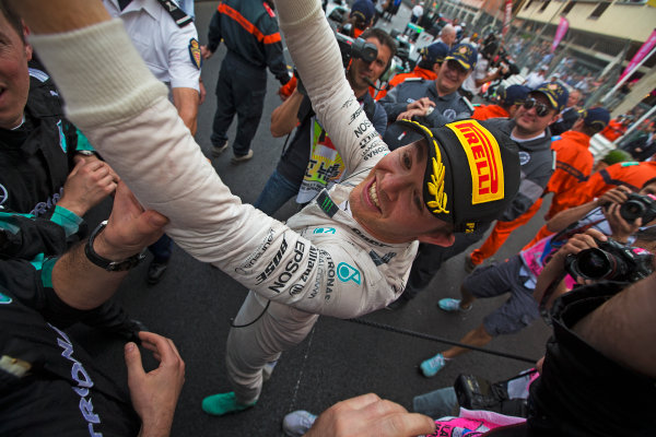 Monte Carlo, Monaco. Sunday 24 May 2015. Nico Rosberg, Mercedes AMG, 1st Position, celebrates in Parc Ferme with Mercedes team mates. World Copyright: Sam Bloxham/LAT Photographic. ref: Digital Image _SBL2751