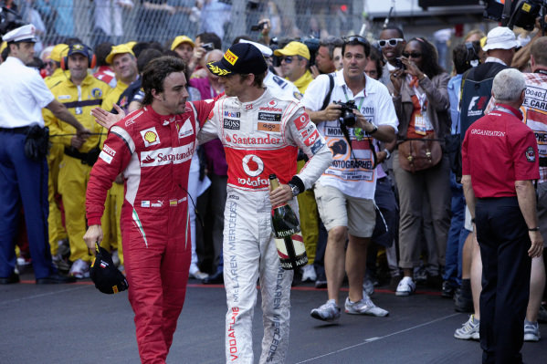 Fernando Alonso with Jenson Button.