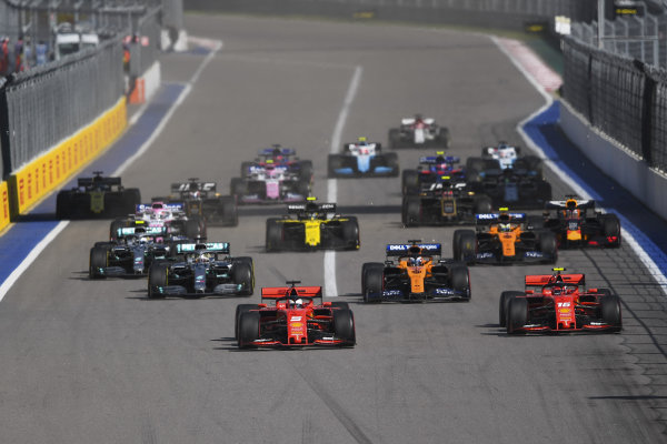 Sebastian Vettel, Ferrari SF90, overtakes Charles Leclerc, Ferrari SF90 at the start