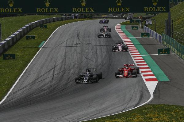 Romain Grosjean (FRA) Haas VF-17 and Kimi Raikkonen (FIN) Ferrari SF70-H at Formula One World Championship, Rd9, Austrian Grand Prix, Race, Spielberg, Austria, Sunday 9 July 2017.