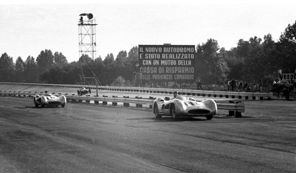 1955 Italian Grand Prix. Monza, Italy. 9-11 September 1955. Winner Juan Manuel Fangio leads Stirling Moss (both stream-lined Mercedes-Benz W196) in front of the banking. Fangio finished in 1st position. World Copyright - LAT Photographic Ref: 338#6
