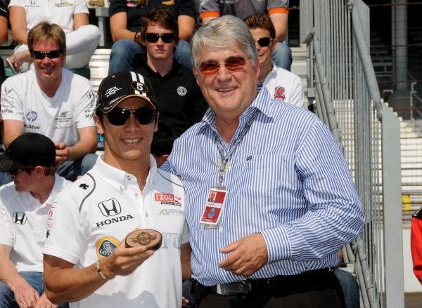 29 May, 2010, Indianapolis, Indiana, USATakuma Sato receives his ring for starting the 94th running of the Indianapolis 500.©2010, Paul Webb, USALAT Photographic