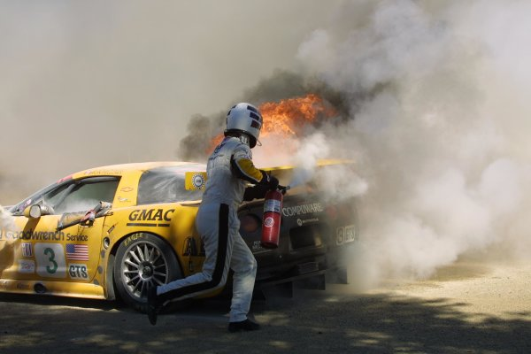 2002 ALMS Laguna SecaMonterey, California USA September 19 - 22, 2002Johnny O'Connell attempts to extinquish fire in his Corvette.World Copyright, Juha Lievonen/LAT Imageref: Digital Image Only