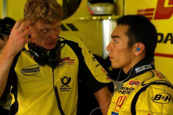 Takuma Sato (JPN) Jordan Honda, right, talks with his physio Martin Whittingham (GBR).Formula One Testing, Barcelona, Spain, 25 June 2002.