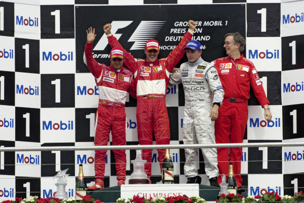 Podium group photo: Felipe Massa, 2nd position, teammate and winner Michael Schumacher, Kimi Räikkönen, 3rd position and Ferrari Engine Director Paolo Martinelli.