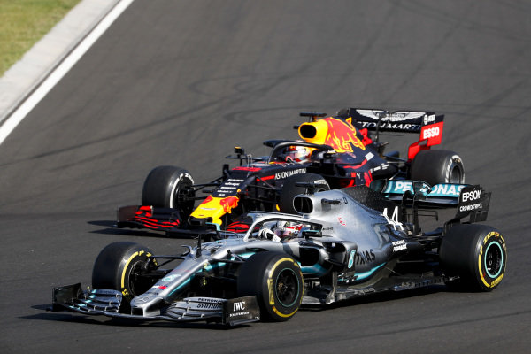 Lewis Hamilton, Mercedes AMG F1 W10 overtakes Max Verstappen, Red Bull Racing RB15 for the lead of the race