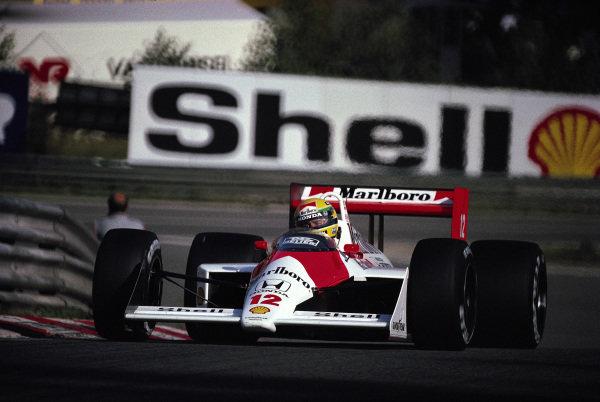 Ayrton Senna, McLaren MP4-4 Honda, at Eau Rouge.