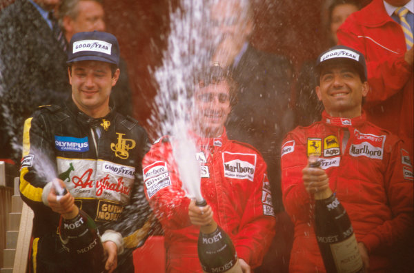 Monte Carlo, Monaco.15-19 May 1985.Alain Prost (McLaren TAG Porsche) 1st position, Elio de Angelis (Lotus Renault) 2nd position and Michele Alboreto (Ferrari) 3rd position on the podium.Ref-85 MON 04.World Copyright - LAT Photographic