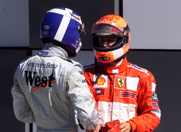 2001 American Grand Prix - RaceIndianapolis, United States. 30th September 2001.Michael Schumacher, Ferrari F2001, and David Coulthard, West McLaren Mercedes MP4/16, congratulate each other on their 2nd and 3rd place finishes.World Copyright: Steve Etherington/LAT Photographicref: 18mb Digital Image
