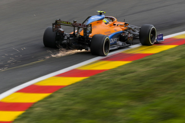 Lando Norris, McLaren MCL35, kicks up some sparks