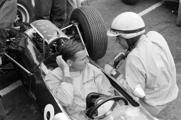 Bruce McLaren chats with Phil Hill.