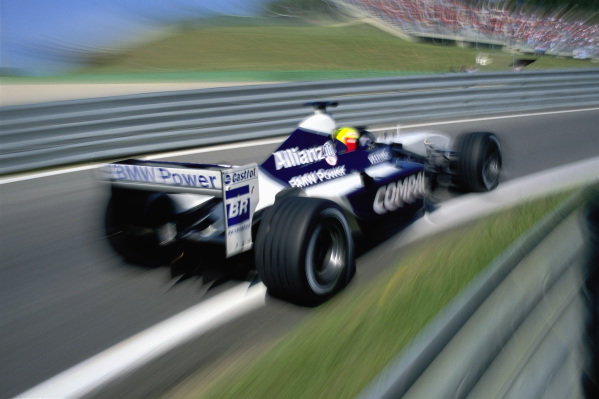 Ralf Schumacher, Williams FW24 BMW, in the pit exit.