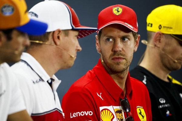 Sebastian Vettel, Ferrari and Kimi Raikkonen, Alfa Romeo Racing talk in the Press Conference
