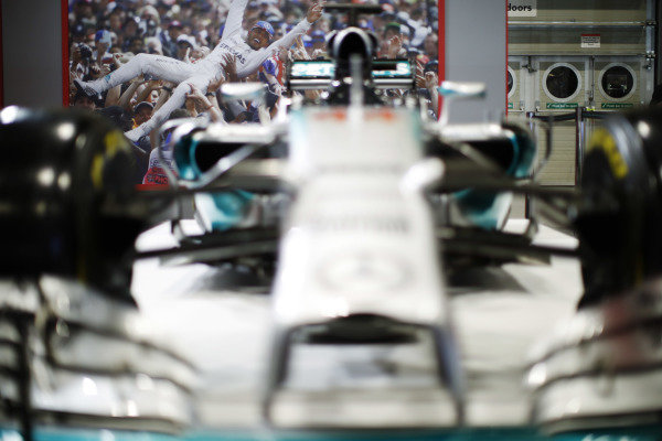 A view across Lewis Hamiton's AMG Mercedes-Benz of an image of Hamilton celebrating winning one of his five titles with team