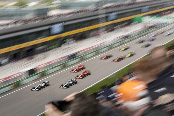 Valtteri Bottas, Mercedes AMG W10, Lewis Hamilton, Mercedes AMG F1 W10, Sebastian Vettel, Ferrari SF90 and Charles Leclerc, Ferrari SF90 at the start of the race