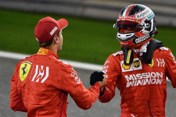 Sebastian Vettel, Ferrari, and Charles Leclerc, Ferrari, congratulate each other on locking out the front row