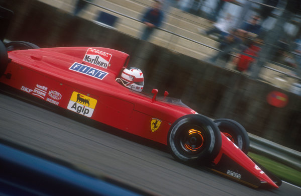 1990 British Grand Prix.Silverstone, England.13-15 July 1990.Nigel Mansell (Ferrari 641). He was leading the race when his gearbox began to malfunction, until finally on lap 55 it failed completely.Ref-90 GB 20.World Copyright - LAT Photographic