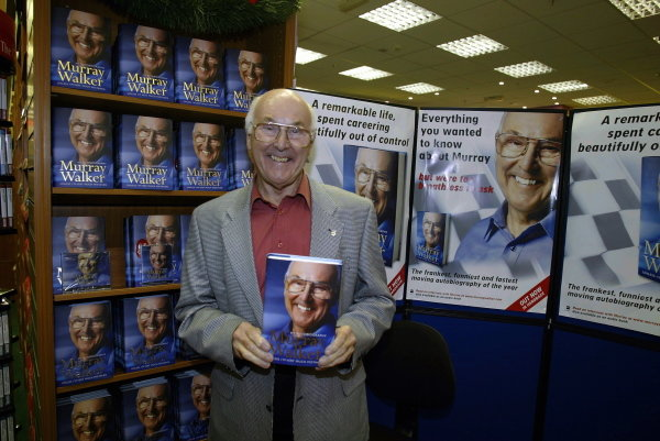 TV commentating legend Murray Walker (GBR) stages another leg of his mammoth nationwide booksigning tour of his Autobiography entitled 'Unless I Am Very Much Mistaken.' Murray Walker Booksigning, Ottakars Bookshop, Milton Keynes, England, 12 November 2002. DIGITAL IMAGE