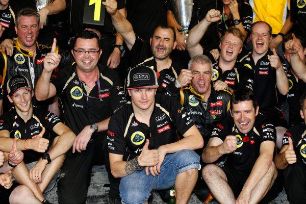 Yas Marina Circuit, Abu Dhabi, United Arab Emirates Sunday 4th November 2012. Kimi Raikkonen, Lotus GP celebrates winning the 2012 Abu Dhabi grand prix with his team. World Copyright:Charles Coates/  ref: Digital Image _N7T7785