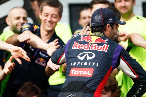 Hungaroring, Budapest, Hungary. Sunday 27 July 2014. Daniel Ricciardo, Red Bull Racing, 1st Position, celebrates with his team. World Copyright: Sam Bloxham/LAT Photographic. ref: Digital Image _SBL1279