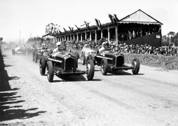 """1935 Dieppe Grand Prix Dieppe, France. 21 July 1935 Rene Dreyfus, Alfa Romeo Tipo-B """"P3"""", 1st position, leads Louis Chiron, Alfa Romeo Tipo-B """"P3"""", 2nd position, Marcel Lehoux, Maserati 6C-34, retired, and Giuseppe Farina, Maserati 6C-34, 5th position, at the start, action World Copyright: Robert Fellowes/LAT PhotographicRef: 35DIE04"""