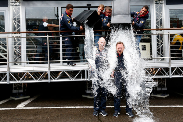 Spa-Francorchamps, Spa, Belgium. Saturday 23 August 2014. Adrian Newey, Chief Technical Officer, Red Bull Racing, and Christian Horner, Team Principal, Red Bull Racing. receive a soaking from Sebastian Vettel, Red Bull Racing, and Daniel Ricciardo, Red Bull Racing, after being nominated for the Ice Bucket Challenge. World Copyright: Alastair Staley/LAT Photographic. ref: Digital Image _R6T4855