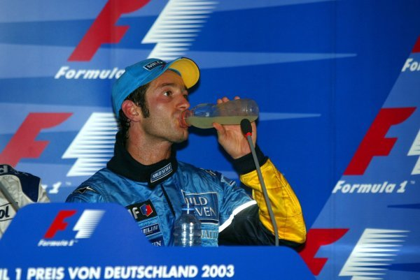 An exhausted third placed Jarno Trulli (ITA) Renault in the press conference. 
