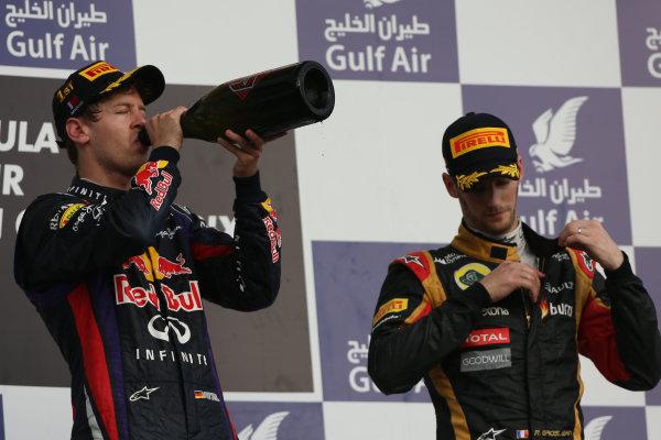 Bahrain International Circuit, Sakhir, Bahrain Sunday 21st April 2013 Sebastian Vettel, Red Bull Racing, 1st position, and Romain Grosjean, Lotus F1, 3rd position. World Copyright: Andy Hone/LAT Photographic ref: Digital Image HONZ3170