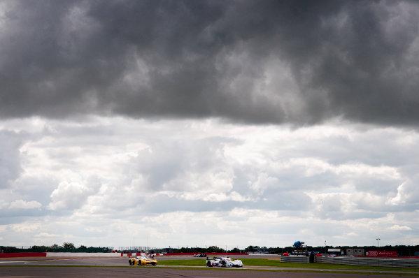 Silverstone, England. 24th - 26th August 2012. Rd 4.Andre Lotterer (GER), Marcel Fassler (CHE), Benoit Treluyer (FRA), Audi Sport Team Joest, Audi R18 E-Tron Quatrro, Action, World Copyright: Chris Bird/LAT Photographic.Ref:  _CJB7870