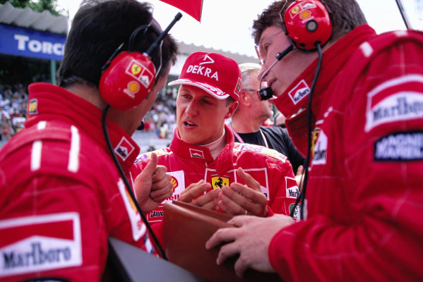 Michael Schumacher with Francesco Barletta and Ross Brawn on the grid.