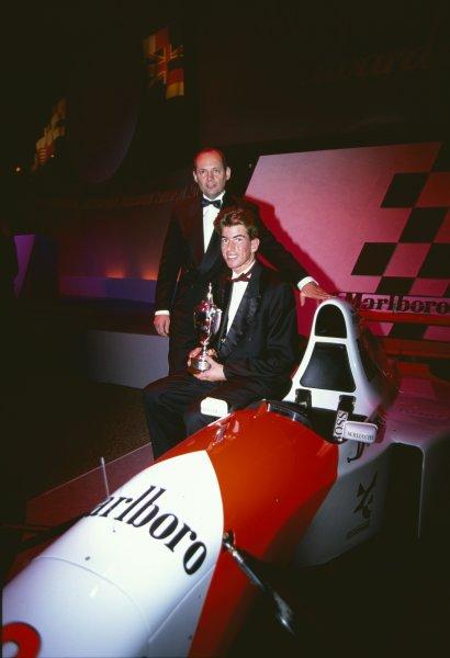 1993 Autosport Awards. Grosvenor House Hotel, Park Lane, London, Great Britain. 5th December 1993. Ralph Firman jr receives the Autosport/McLaren BRDC Young Driver Award from Ron Dennis. World Copyright: LAT Photographic Ref: 35mm transparency