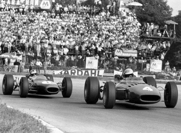 1966 Italian Grand Prix. Monza, Italy. 4th September 1966. Michael Parkes, Ferrari 312, 2nd position, leads Denny Hulme, Brabham BT20-Repco, 3rd position, action. World Copyright: LAT Photographic Ref: Motor b&w print