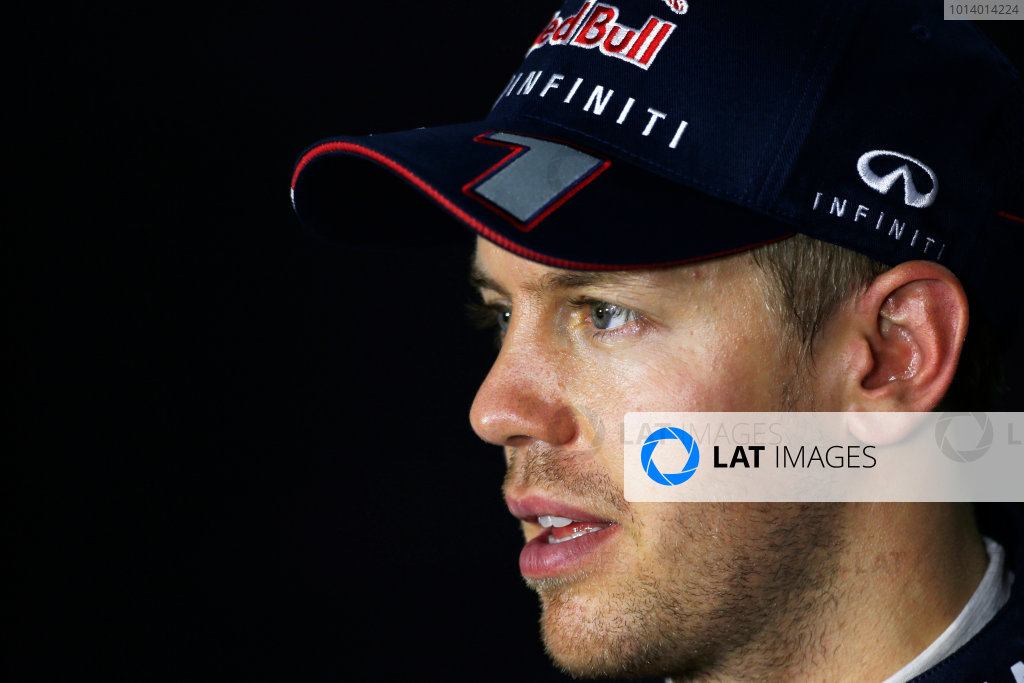 Marina Bay Circuit, Singapore. Saturday 21st September 2013.  Sebastian Vettel, Red Bull Racing, in the press conference after qualifying.  World Copyright: Charles Coates/LAT Photographic. ref: Digital Image _N7T5446