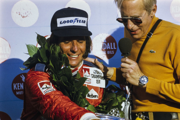 Emerson Fittipaldi celebrates his second world championship on the podium.