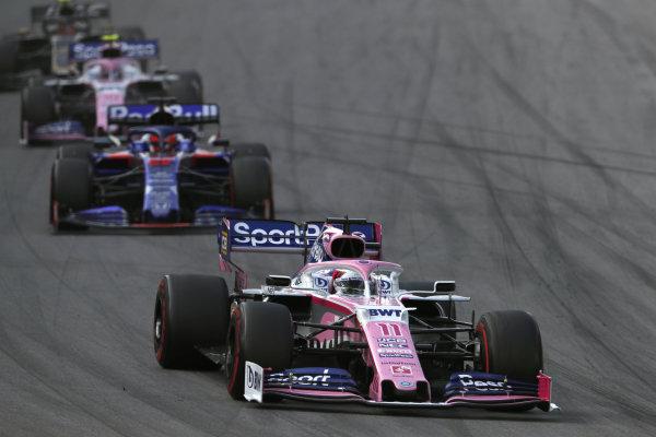 Sergio Perez, Racing Point RP19, leads Daniil Kvyat, Toro Rosso STR14, and Lance Stroll, Racing Point RP19
