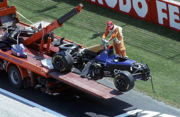 The destroyed remains of Roland Ratzenberger's Simtek S941 Ford is recovered on a flatbed.