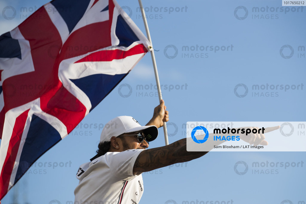 Lewis Hamilton, Mercedes AMG F1, 1st position, celebrates with a Union flag