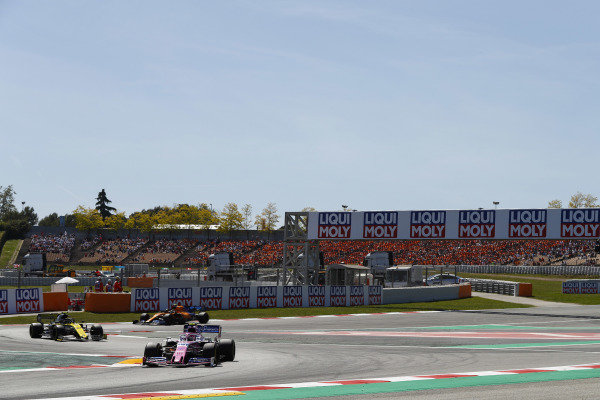 Lance Stroll, Racing Point RP19, leads Nico Hulkenberg, Renault R.S. 19, and Lando Norris, McLaren MCL34