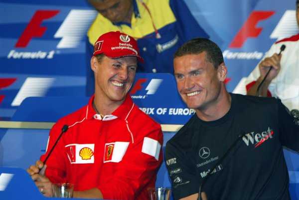 2002 European Grand Prix Grand Prix - PreviewNurburgring, Germany. 20th June 2002Michael Schumacher (Ferrari) has a laugh with David Coulthard (McLaren Mercedes) in a press conference.World Copyright: Steve Etherington/LATref: Digital Image Only