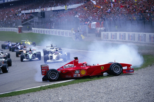 Michael Schumacher, Ferrari F1-2000, spins off into the gravel after a collision.