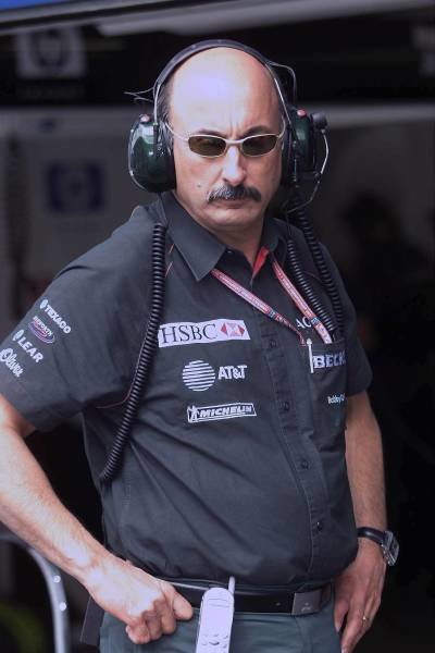 Bobby Rahal (USA) Jaguar Racing Team Manager looks at the R2 hoping for a result in Spielberg. Austrian Grand Prix Practice, A1-Ring 11 May 2001 DIGITAL IMAGE