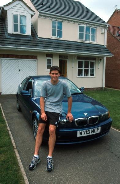 Mark Webber (AUS) at home with his BMW road car. Drivers at Home Feature, 16 July 2000