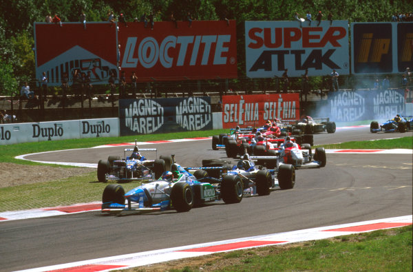 Monza, Italy.6-8 September 1996.Jean Alesi (Benetton B196 Renault) leads Damon Hill and Jacques Villeneuve (Williams FW18 Renault) who cuts the Rettifilo Chicane at the start.Ref-96 ITA 10.World Copyright - LAT Photographic